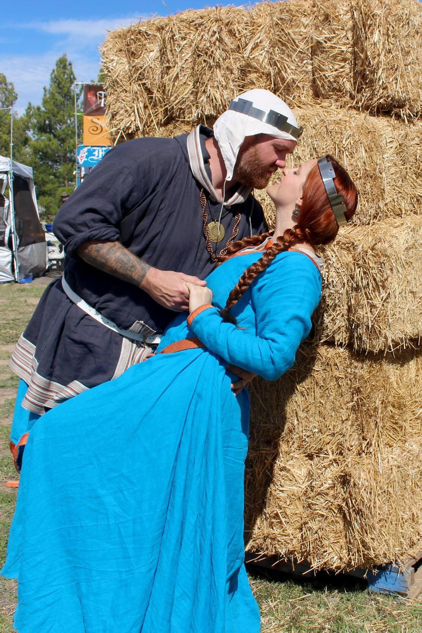 Brian dipping Lia into a kiss in front of haybales at Estrella War town square