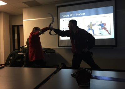 two men demonstrating medieval fighting with sickles